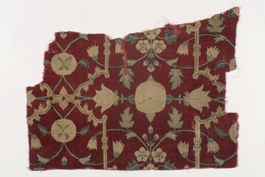 Fragment of a Carpet with Pattern of Lattice and Blossoms, mid 17th century. Pashmina wool, silk, 18 1/2 x 25 in. (47 x 63.5 cm). Brooklyn Museum, Brooklyn Museum Collection, X1103.1. Creative Commons-BY
