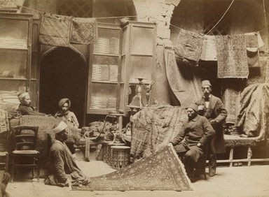 Brooklyn Museum: [Untitled] (Rug Merchant at Bazaar in Cairo)