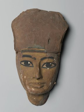 Face from a Coffin, 1075-656 B.C. Wood, plaster, pigment, 6 1/16 x 3 1/8 x 10 7/16 in. (15.4 x 7.9 x 26.5 cm). Brooklyn Museum, Brooklyn Museum Collection, X1182.3. Creative Commons-BY