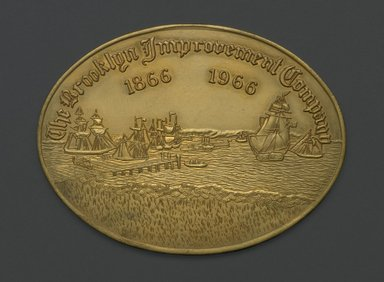 American. Coin, The Brooklyn Improvement Company 1866 - 1966, ca. 1966. Gilded metal, 3 1/16 x 4 1/16 x 1/8 in. (7.8 x 10.3 x 0.3 cm). Brooklyn Museum, Brooklyn Museum Collection, X1195. Creative Commons-BY