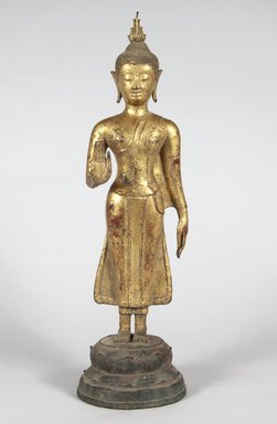 Standing Buddha. Gilded bronze, polychrome, 18 7/8 x 5 1/2 x 5 in. (47.9 x 14 x 12.7 cm). Brooklyn Museum, Brooklyn Museum Collection, X630
