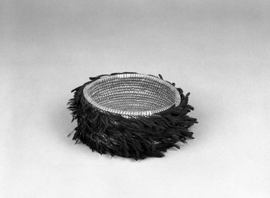 Possibly Pomo (Native American). Coiled Basket, late 19th-early 20th century. Feathers, fiber, 2 1/8 x (dia) 4 1/2 in. (5.4 x 11.4 cm). Brooklyn Museum, Brooklyn Museum Collection, X719.4. Creative Commons-BY