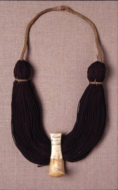 Hawaiian. Necklace (Lei Niho Palaoa), early 19th century. Human hair, ivory, fiber, Display: 14 x 7 x 2 1/2 in. (35.6 x 17.8 x 6.4 cm). Brooklyn Museum, Brooklyn Museum Collection, X839.3. Creative Commons-BY