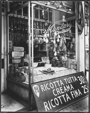 Berenice Abbott (American, 1898-1991). Cheese Store: 276 bleeker Street, Manhattan, February 2, 1937. Gelatin silver photograph, 9 9/16 x 7 9/16 in. (24.3 x 19.2 cm). Brooklyn Museum, Brooklyn Museum Collection, X858.41