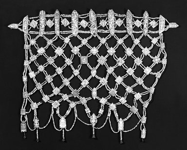 Ritual Apron (Rugyan), 16th century. Carved human and animal bone plaques and beads, 28 x 35 x 3/4 in. (71.1 x 88.9 x 1.9 cm). Brooklyn Museum, Brooklyn Museum Collection, X887.2. Creative Commons-BY