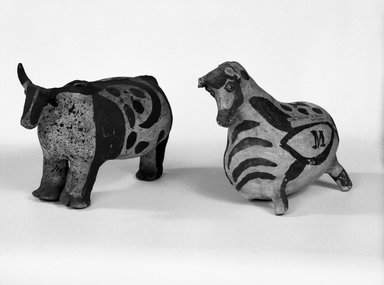 She-we-na (Zuni Pueblo) (Native American). Four Legged Effigy Vessel in the Shape of a Cow, ca. 1875. Clay, 5 3/4 x 7 3/4 in. (14.6 x 19.7 cm). Brooklyn Museum, Brooklyn Museum Collection, X898.4. Creative Commons-BY