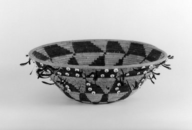 Pomo (Native American). Gift or Jewel Basket with black and red feathers, late 19th-early 20th century. Fiber, feather, shell bead, 2 3/4 x 9 1/4 in. (7 x 23.5 cm). Brooklyn Museum, Brooklyn Museum Collection, X719.1. Creative Commons-BY