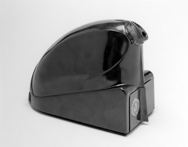 "Stile Craft Manufacturers, Inc.. Pencil Sharpener, ""Electro-Pointer,"" ca. 1930. Molded plastic, metal, 5 7/8 x 3 5/8 x 8 1/4 in. (14.9 x 9.2 x 21 cm). Brooklyn Museum, Brooklyn Museum Collection, X908a-c. Creative Commons-BY"