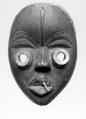 Dan. Mask, late 19th or early 20th century. Wood, metal, tooth, plastic?, 8 x 5 1/2 x 4in. (20.3 x 14 x 10.2cm). Brooklyn Museum, Brooklyn Museum Collection, X956.5. Creative Commons-BY