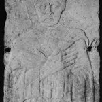 Carved Tomb Slab.  Relief, half-length portrait of beardless manwith eyes closed, hands crossed on breast.