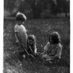 Three Children in the Grass