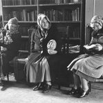 Catholic Workers (Three Women Seated in the Headquaters on Newspaper)