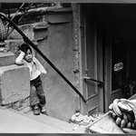 Lower East Side N.Y.C (Child on Stairs with Bananas and Potatoes)