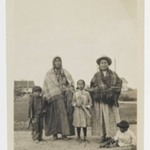 [Untitled] (Two Women Standing near Three Children)