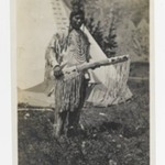 [Untitled] (Native American Chief Standing in front of Teepee)