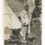 [Untitled] (Chief Standing in front of Teepee with Seated Woman)