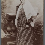 Studio Shot of Woman with White Charhad Leaning against Wooden Balastradein Western Costume Leaning on Balustrade, One of 274 Vintage Photographs