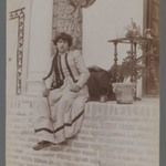 Woman in European Costume Seated on a Veranda Holding a Violin Bow, One of 274 Vintage Photographs