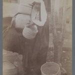 Woman Carrying Baskets with Veil Thrown Aside, One of 274 Vintage Photographs