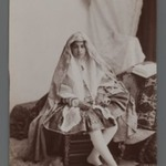 Studio Shot of Young Girl Seated Beside an Open Book,  One of 274 Vintage Photographs