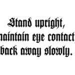 Stand upright-maintain eye contact, back away slowly