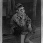 Seated Boy Smoking a Cigar