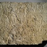 Relief of Khamwasemen and His Wife Seated at the Table of Offerings with Standing Priest