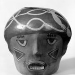 Vessel in Form of a Trophy Head