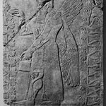 Relief of Winged Man-Headed Figure Facing Right with Basket and Fircone