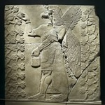 Relief of Eagle-Headed Winged Figure Standing Between Two Sacred Trees