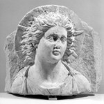 Head of Helios in High Relief Against a Pedimental Background