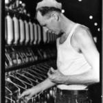 [Untitled] (Man in Cap Holding Thread)