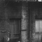 [Untitled] (Tenement, Child on Fire Escape, New York)