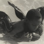 [Untitled] (Boy with Rubber Dolphin)