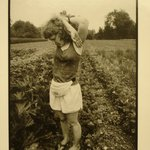 Jessy Park with Her Arms Raised in a Vegetable Garden, Williamstown, MA, from the Born Electrical Series