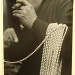 Man with Pearls over His Arm, Lower East Side, New York City