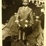 [Untitled] (Boy with Flag at Funeral)