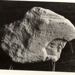 Small Flake Containing the Head of a Man in Deep Relief