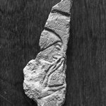 Small Flake with Head of a Man Holding His Hand