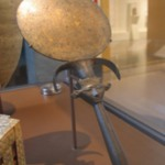 Mirror with Papyrus Column Handle Ending in Hathor Capital