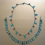 Single Strand Necklace with Hathor Head Beads and a Scarab