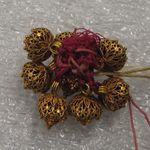Set of Eight Filigree Buttons
