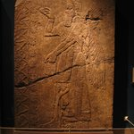 Relief of Winged Man-Headed Figure Facing Right Holding Fircone and Basket Anointing the Sacred Tree