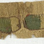Fragment with Tapestry Strip of Flowers and Ovals