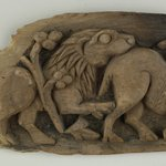 Charred Fragment of a Panel with Animal Scene in Bold Relief