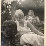 Swedish Model (Blonde Woman in White Dress Leaning Against Statue of a Head)