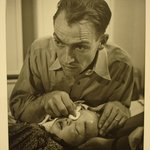 [Untitled] (Dr. Ernest Ceriani Swabbing Eye of Child)