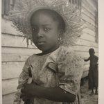 [Untitled] (Child with Straw Hat and Crutches)
