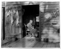 Lewis Wickes Hine (American, 1874-1940). Mountain Woman in Doorway, 1931. Gelatin silver photograph, sheet: 15 1/2 x 19 1/2 in. Brooklyn Museum, Gift of Naomi and Walter Rosenblum, 1990.241.1. © artist or artist's estate