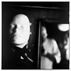 Bruce Cratsley (American, 1944-1998). Glass Shop Mask, 1987. Gelatin silver photograph, image: 9 x 9 in. (22.9 x 22.9 cm). Brooklyn Museum, Alfred T. White Fund, 1991.23.1. © artist or artist's estate